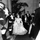 La princesse Margaret d'Angleterre accompagnee de Sir Oliver Harvey lors d'un voyage a Paris saluee par la garde republicaine lors de son arrivee au bal du Cercle Interallie au benefice du British Hertford Hospital le 21 novembre  1951  (elle porte le diademe en diamants Cartier que portera KateMiddleton pour son mariage en -2011) --- Princess Margaret with Sir Oliver Harvey in Paris arriving at a charity ball November 21, 1951 (diamond tiara by Cartier worn by KateMiddleton for her wedding in -2011)